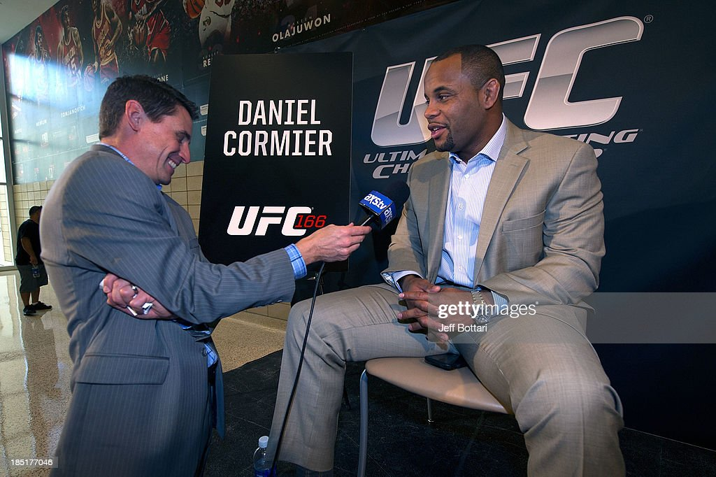 <a gi-track='captionPersonalityLinkClicked' href=/galleries/search?phrase=Daniel+Cormier&family=editorial&specificpeople=171300 ng-click='$event.stopPropagation()'>Daniel Cormier</a> speaks with the media during the UFC 166 Ultimate Media Day at the Toyota Center on October 16, 2013 in Houston, Texas.
