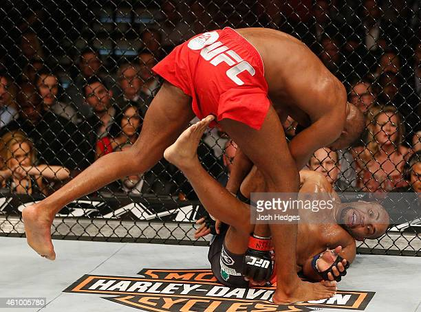 Daniel Cormier takes down Daniel Cormier in their UFC light heavyweight championship bout during the UFC 182 event at the MGM Grand Garden Arena on...