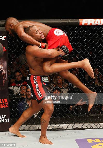 Daniel Cormier takes down Jon Jones in their UFC light heavyweight championship bout during the UFC 182 event at the MGM Grand Garden Arena on...