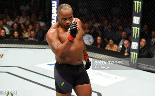Daniel Cormier taunts opponent Jon Jones not pictured in their UFC light heavyweight championship bout during the UFC 214 event at Honda Center on...