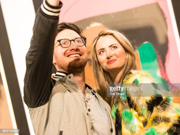 Daniel Cowen and Kate Painting during the opening of the Andy Warhol exhibition at the Wits Art Museum on July 26 2017 in Johannesburg South Africa...