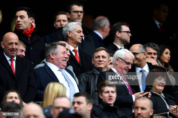 Daniel Craig actor looks on from the stands during the Premier League match between Liverpool and Everton at Anfield on April 1 2017 in Liverpool...