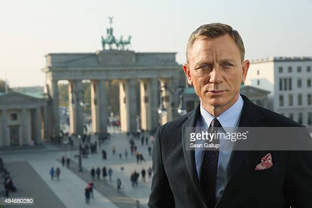 Daniel Craig poses with the Brandenburg Gate behind during a photocall prior the German premiere of the new James Bond movie 'Spectre' at Hotel Adlon...