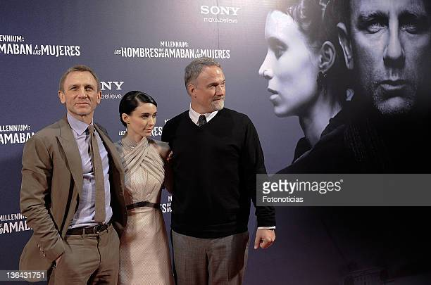 Daniel Craig Rooney Mara and David Fincher attend the premiere of 'Millenium The Girl With the Dragon Tattoo' at Callao CInema on January 4 2012 in...