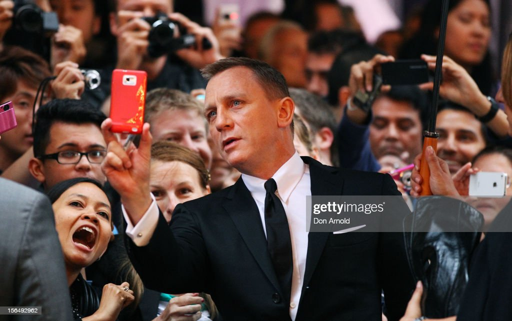 Daniel Craig takes a photo of himself with fans at the 'Skyfall' Australian Premiere at the State Theatre on November 16, 2012 in Sydney, Australia.