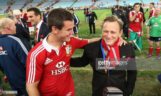Daniel Craig the James Bond actor celebrates with Lions standoff Jonathan Sexton during the International Test match between the Australian Wallabies...