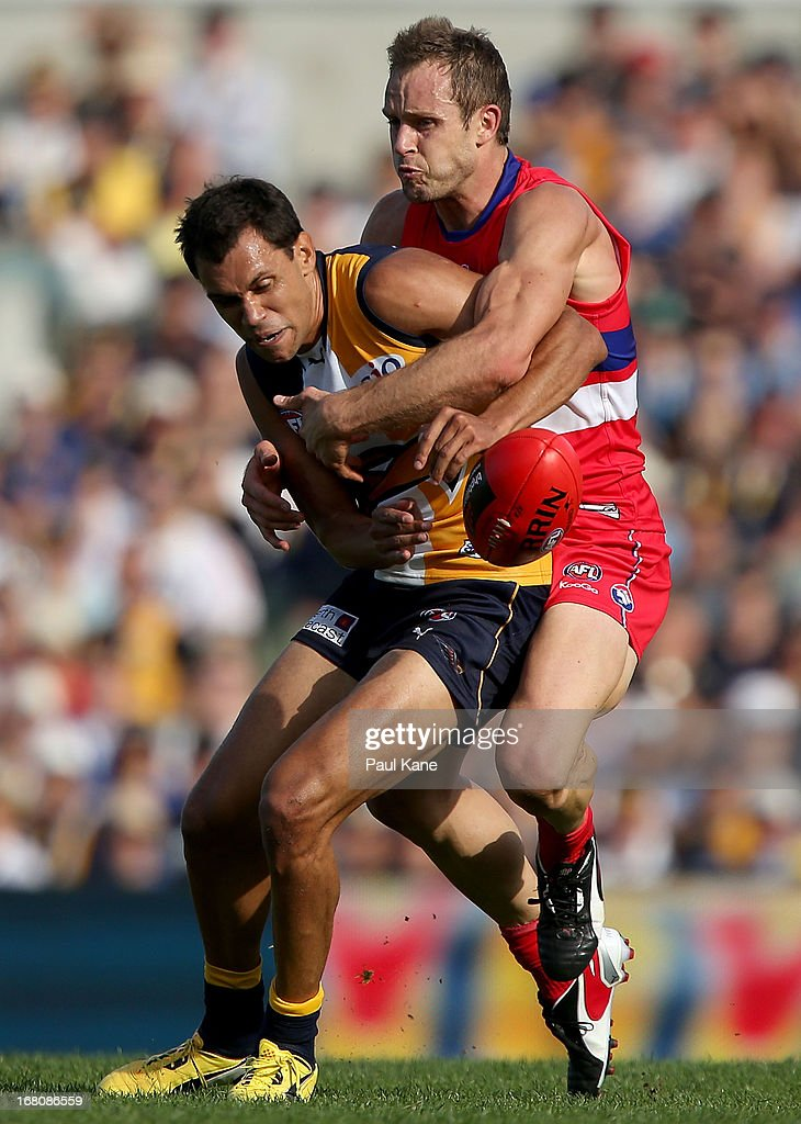 Daniel Cross of the Bulldogs tackles Josh Hill of the Eagles during the round six AFL match between the West Coast Eagles and the Western Bulldogs at Patersons Stadium on May 5, 2013 in Perth, Australia.