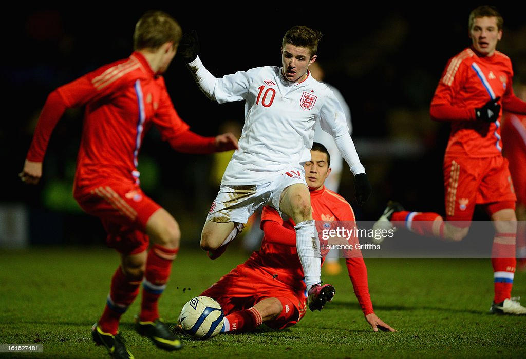 Daniel Crowley of England battles with Dzhamaldin Khodzhaniiazov of Russia during the UEFA European Under-17 Championship Elite Round match between England Under-17 and Russia U-17at Pirelli Stadium on March 25, 2013 in Burton-upon-Trent, England.