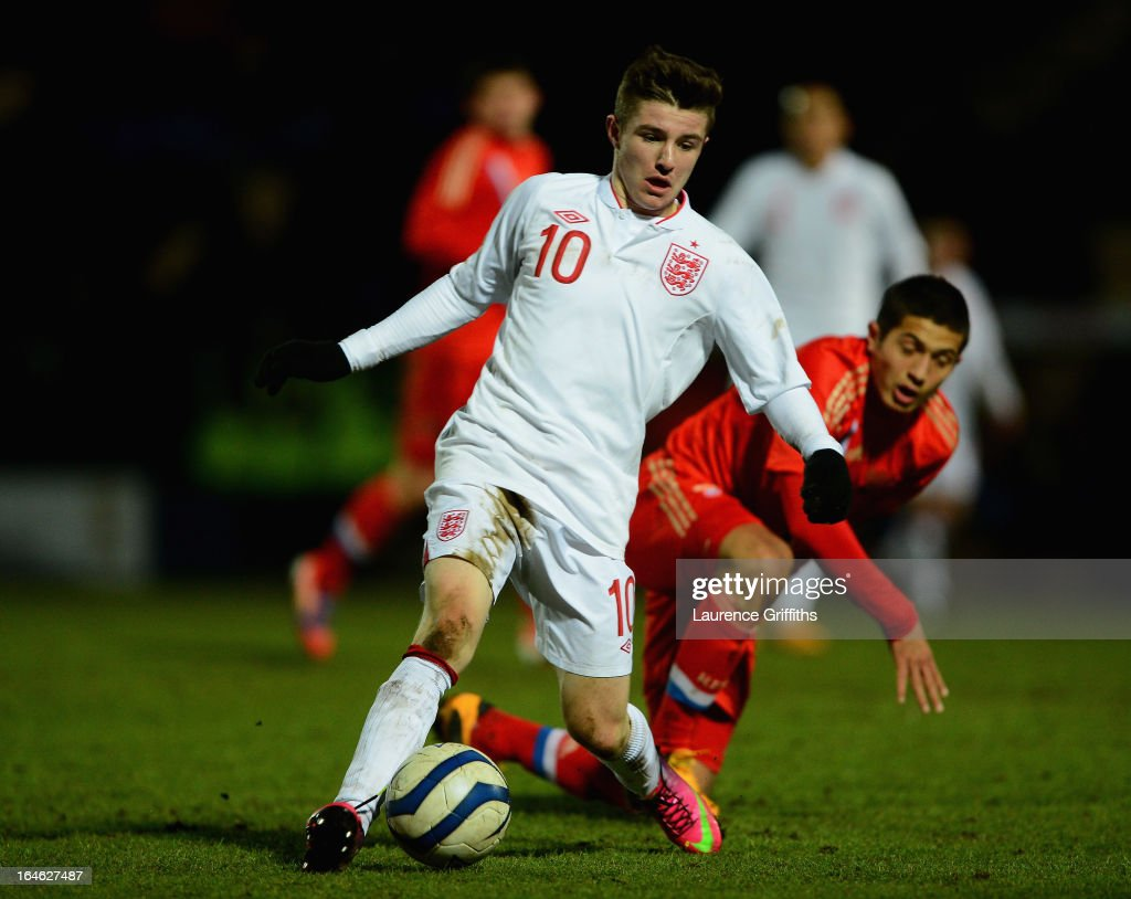 Daniel Crowley of England battles with Dzhamaldin Khodzhaniiazov of Russia during the UEFA European Under-17 Championship Elite Round match between England Under-17 and Russia U-17at Pirelli Stadium on March 25, 2013 in Burton-upon-Trent, England.