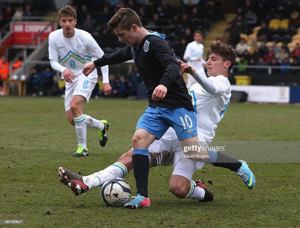 Daniel Crowley of England is challenged by Jon Gorenc Stankovic during the UEFA European Under 17 Championship match between England and Slovenia at Pirelli Stadium on March 28, 2013 in Burton-upon-Trent, England.