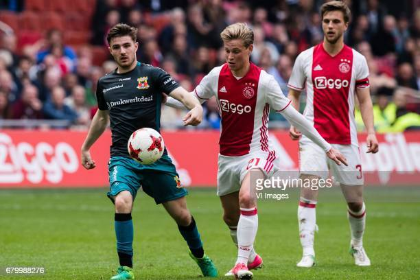 Daniel Crowley of Go Ahead Eagles Frenkie de Jong of Ajaxduring the Dutch Eredivisie match between Ajax Amsterdam and Go Ahead Eagles at the...