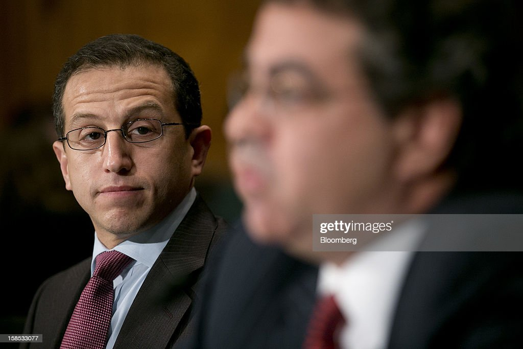 Daniel 'Dan' Mathisson, head of U.S. equity trading for Credit Suisse Group AG, left, looks on as Eric Noll, executive vice president and head of transaction services at Nasdaq OMX Group Inc., speaks during a Senate Banking Committee hearing in Washington, D.C., U.S., on Tuesday, Dec. 18, 2012. NYSE Euronext and Nasdaq OMX Group Inc., their share of American equity markets squeezed by venues that sprang up in the mid-2000s, told legislators that too much trading occurs in dark pools, hurting investors. Photographer: Andrew Harrer/Bloomberg via Getty Images