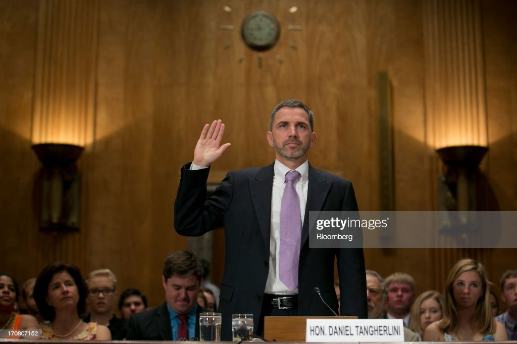 Daniel 'Dan' Tangherlini, acting administrator of the General Services Administration (GSA) and U.S. President Barack Obama's nominee as administrator of the GSA, swears into a Senate Homeland Security and Governmental Affairs nomination hearing in Washington, D.C., U.S., on Tuesday, June 18, 2013. Tangherlini has been GSA acting administrator since April 2012, after then-GSA Administrator Martha Johnson resigned following the release of an inspector general report detailing lavish spending at a 2010 GSA regional conference in Las Vegas. Photographer: Andrew Harrer/Bloomberg via Getty Images