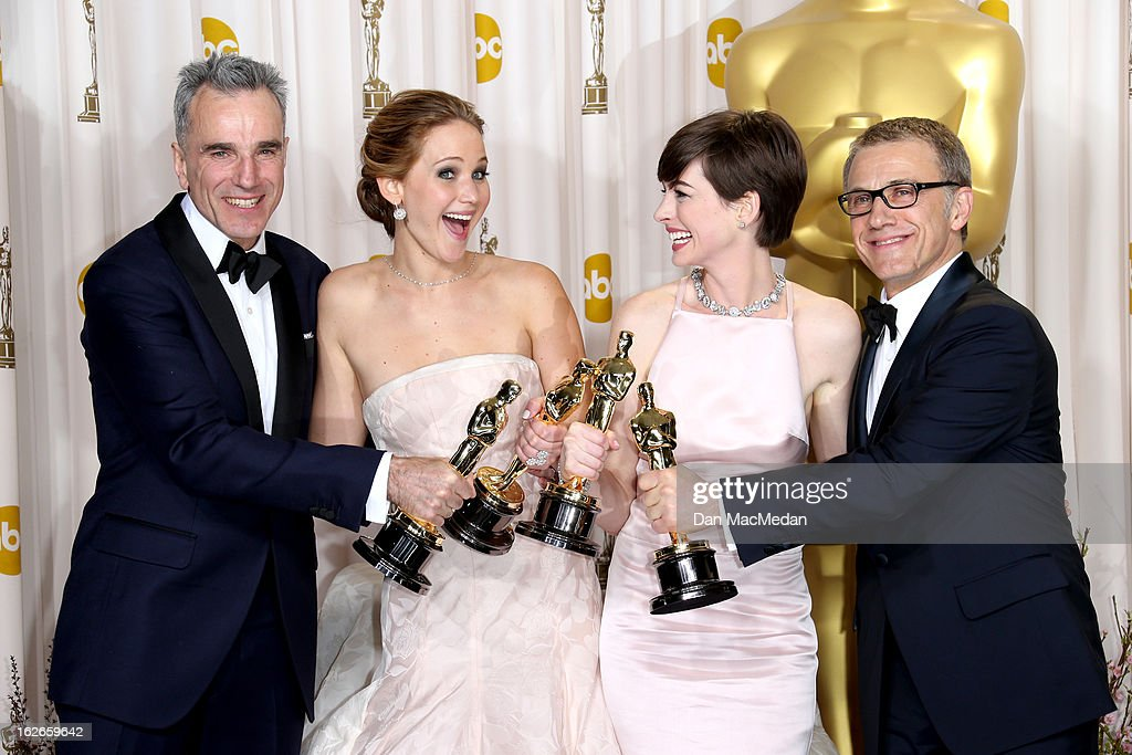 Daniel Day-Lewis, Jennifer Lawrence, Anne Hathaway and Christoph Waltz pose in the press room at the 85th Annual Academy Awards at Hollywood & Highland Center on February 24, 2013 in Hollywood, California.
