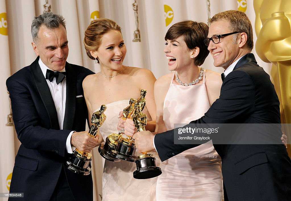 Daniel Day-Lewis, Jennifer Lawrence, Anne Hathaway and Christophe Waltz in the press room during the 85th Annual Academy Awards held at the Loews Hollywood Hotel on February 24, 2013 in Hollywood, California.