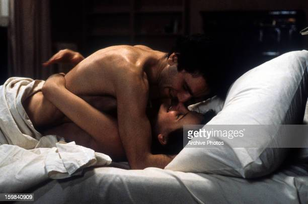 Daniel DayLewis lies in bed with Juliette Binoche in a scene from the film 'The Unbearable Lightness Of Being' 1988