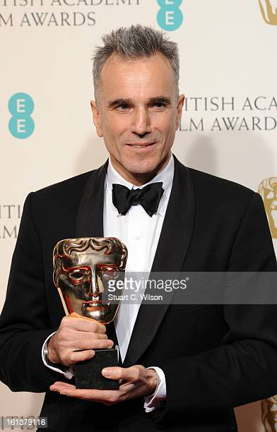 Daniel DayLewis winner of the Leading Actor award for 'Lincoln' poses in the press room at the EE British Academy Film Awards at The Royal Opera...