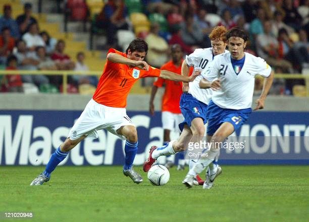 Daniel de Ridder of Holland left and Paolo Sammarco of Italy during the 2006 UEFA European Under 21 Championship Group B match between Italy and...