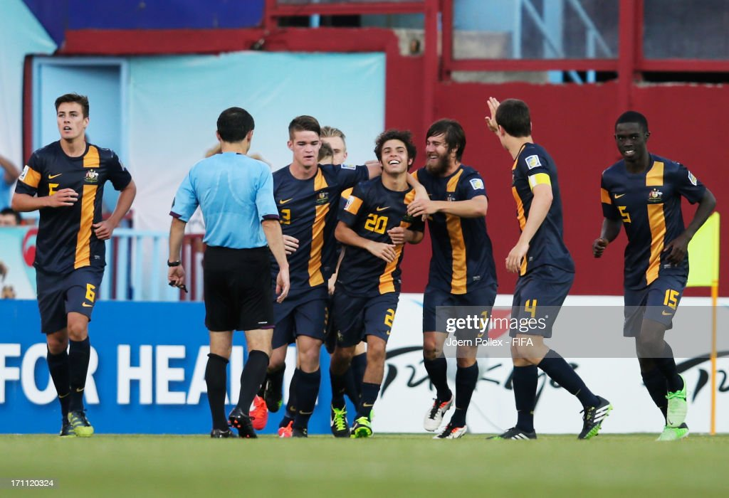 Daniel De Silva (C) of Australia celebrates with his team mates after scoring his team's first goal during the FIFA U-20 World Cup Group C match between Colombia and Australia at Huseyin Avni Aker Stadium on June 22, 2013 in Trabzon, Turkey.