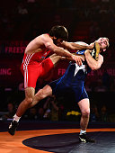 Daniel Dennis of the United States takes down Makhmud Magomedov of Azerbainjan during the 2016 United World Wrestling World Cup at The Forum on June...