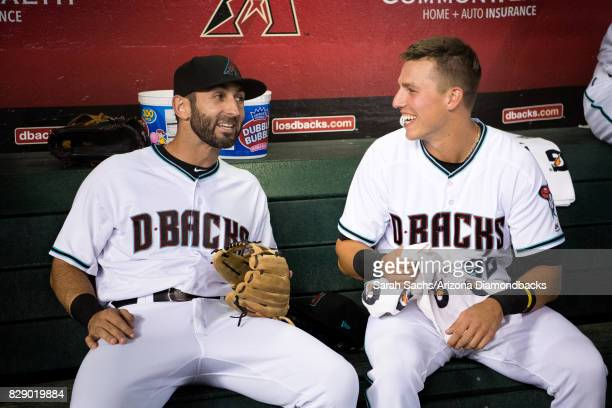 Daniel Descalso and Jake Lamb of the Arizona Diamondbacks talk prior to a game against the Los Angeles Dodgers at Chase Field on August 8 2017 in...