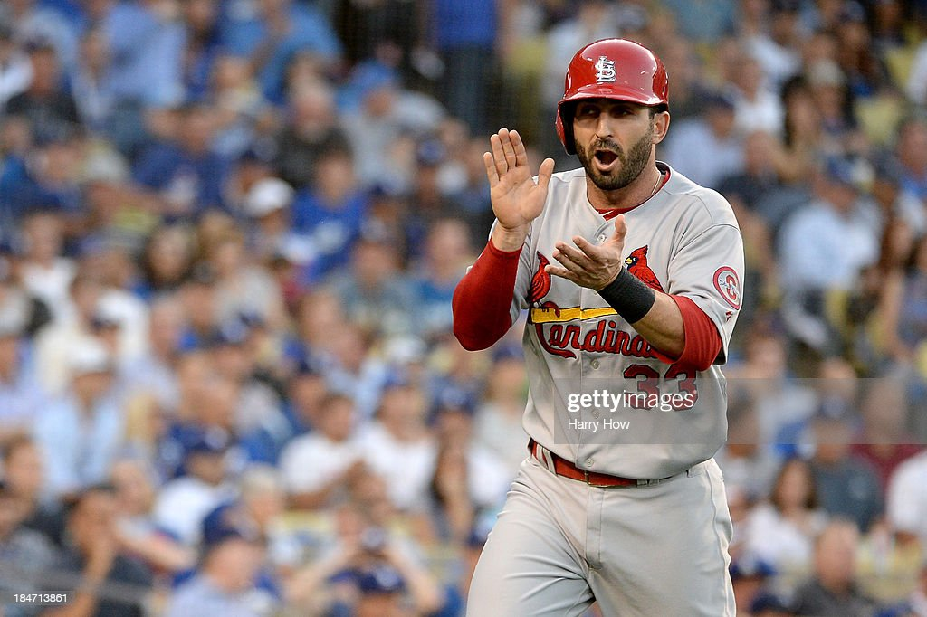 <a gi-track='captionPersonalityLinkClicked' href=/galleries/search?phrase=Daniel+Descalso&family=editorial&specificpeople=6800752 ng-click='$event.stopPropagation()'>Daniel Descalso</a> #33 celebrates after he scores in the third inning against the Los Angeles Dodgers in Game Four of the National League Championship Series at Dodger Stadium on October 15, 2013 in Los Angeles, California.