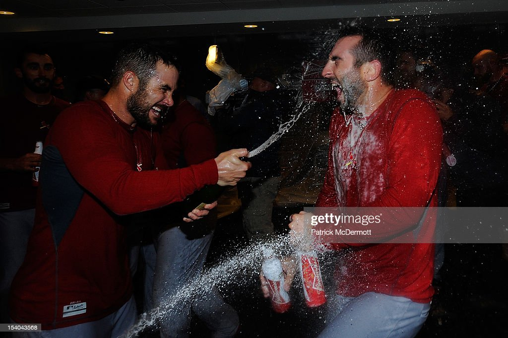 <a gi-track='captionPersonalityLinkClicked' href=/galleries/search?phrase=Daniel+Descalso&family=editorial&specificpeople=6800752 ng-click='$event.stopPropagation()'>Daniel Descalso</a> #33 celebrates with <a gi-track='captionPersonalityLinkClicked' href=/galleries/search?phrase=Skip+Schumaker&family=editorial&specificpeople=640599 ng-click='$event.stopPropagation()'>Skip Schumaker</a> #55 of the St. Louis Cardinals in the locker room after the Cardinals defeated the Washington Nationals 9-7 in Game Five of the National League Division Series at Nationals Park on October 12, 2012 in Washington, DC.