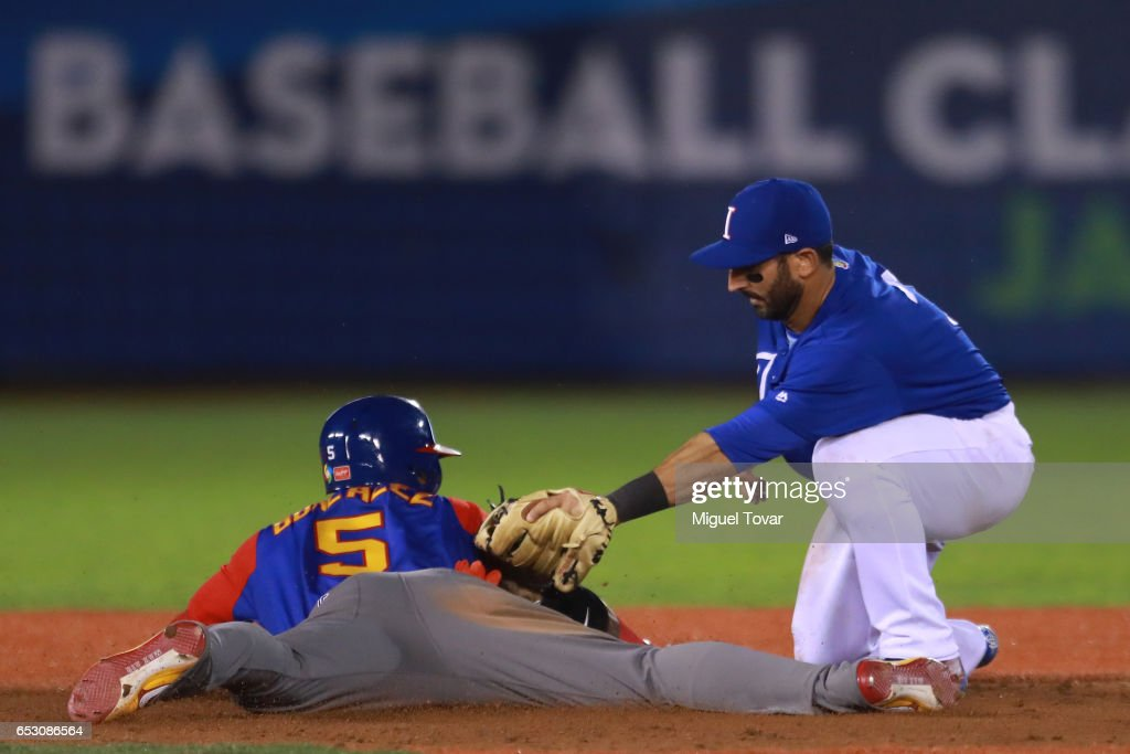 Daniel Descalso #3 of Italy tags out Carlos Gonzalez #5 of Venezuela in the top of the ninth inning during the World Baseball Classic Pool D Game 7 between Venezuela and Italy at Panamericano Stadium on March 13, 2017 in Zapopan, Mexico.