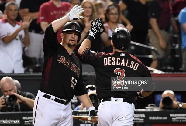 Daniel Descalso of the Arizona Diamondbacks celebrates with teammate Zack Godley after hitting a solo home run off of Miguel Diaz of the San Diego...
