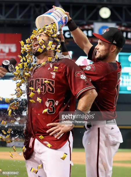 Daniel Descalso of the Arizona Diamondbacks is dunked with bubble gum by Chris Owings after hitting the game winning RBI single against the...