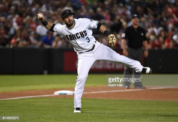 Daniel Descalso of the Arizona Diamondbacks makes a running throw to first base to get a force out during the fourth inning against the Colorado...
