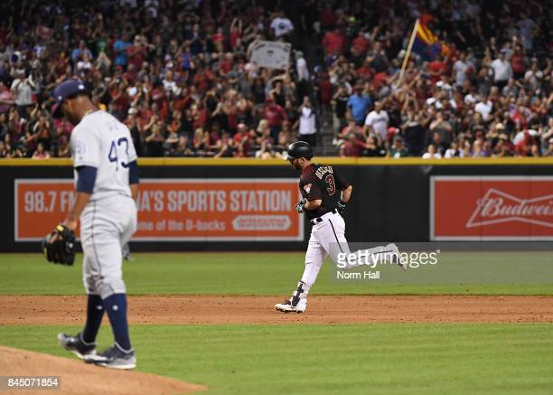 Daniel Descalso of the Arizona Diamondbacks rounds the bases after hitting a solo home run off of Miguel Diaz of the San Diego Padres during the...