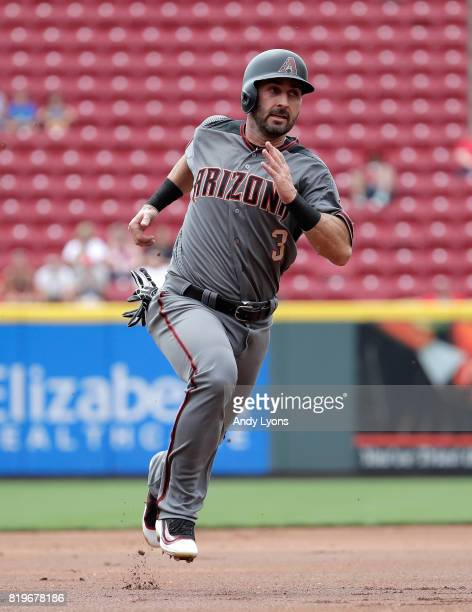 Daniel Descalso of the Arizona Diamondbacks runs to third base in the first inning against the Cincinnati Reds at Great American Ball Park on July 20...