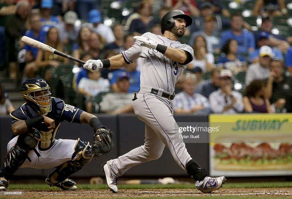 Daniel Descalso #3 of the Colorado Rockies hits a double in the sixth inning against the Milwaukee Brewers at Miller Park on August 22, 2016 in Milwaukee, Wisconsin.