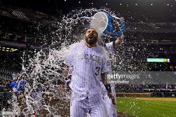 Daniel Descalso of the Colorado Rockies is dunked with ice and powerade after hitting a walk off hit in the ninth inning of a game against the San...