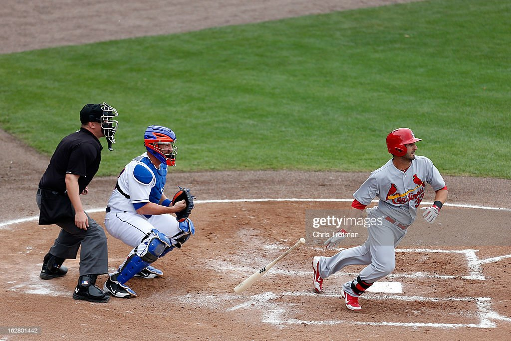 <a gi-track='captionPersonalityLinkClicked' href=/galleries/search?phrase=Daniel+Descalso&family=editorial&specificpeople=6800752 ng-click='$event.stopPropagation()'>Daniel Descalso</a> #33 of the St. Louis Cardinals bats as <a gi-track='captionPersonalityLinkClicked' href=/galleries/search?phrase=John+Buck&family=editorial&specificpeople=213730 ng-click='$event.stopPropagation()'>John Buck</a> #44 of the New York Mets looks on at Tradition Field on February 27, 2013 in Port St. Lucie, Florida.