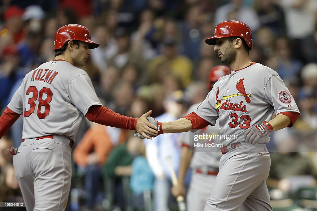 Daniel Descalso #33 of the St. Louis Cardinals celebrates with Pete Kozma #38 after hitting a two-run homer in the top of the seventh inning against the Milwaukee Brewers at Miller Park on May 04, 2013 in Milwaukee, Wisconsin.