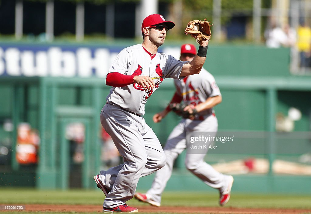 <a gi-track='captionPersonalityLinkClicked' href=/galleries/search?phrase=Daniel+Descalso&family=editorial&specificpeople=6800752 ng-click='$event.stopPropagation()'>Daniel Descalso</a> #33 of the St. Louis Cardinals fields a ground ball against the Pittsburgh Pirates during the game on July 30, 2013 at PNC Park in Pittsburgh, Pennsylvania. The Pirates defeated the Cardinals 2-1 in eleven innings.