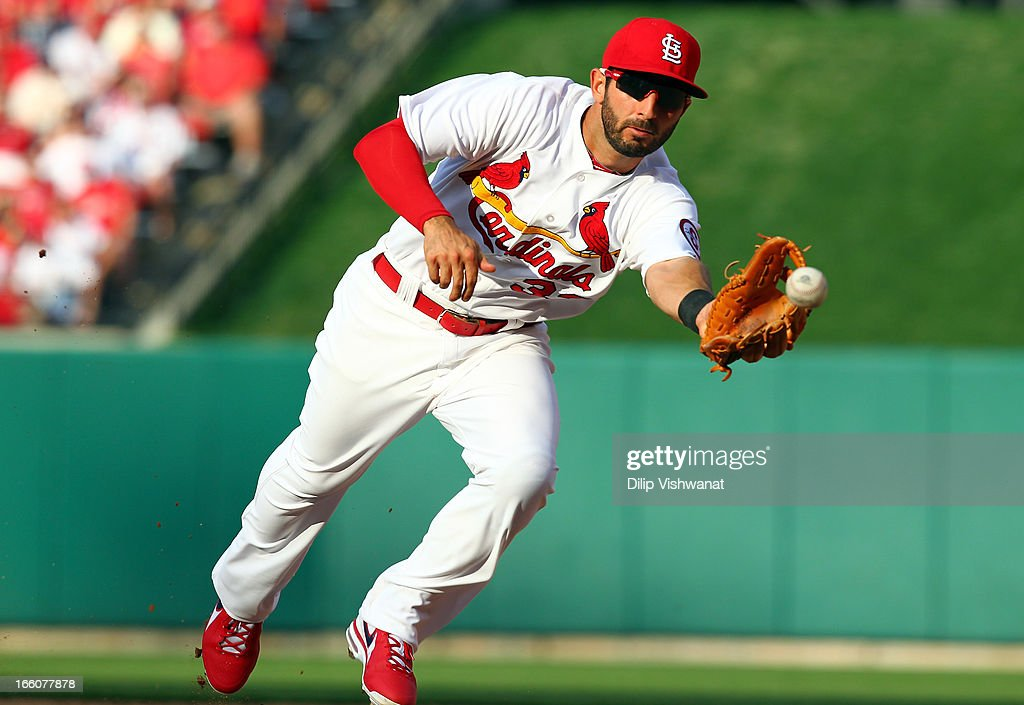 <a gi-track='captionPersonalityLinkClicked' href=/galleries/search?phrase=Daniel+Descalso&family=editorial&specificpeople=6800752 ng-click='$event.stopPropagation()'>Daniel Descalso</a> #33 of the St. Louis Cardinals fields the ball against the Cincinnati Reds during Opening Day on April 8, 2013 at Busch Stadium in St. Louis, Missouri.