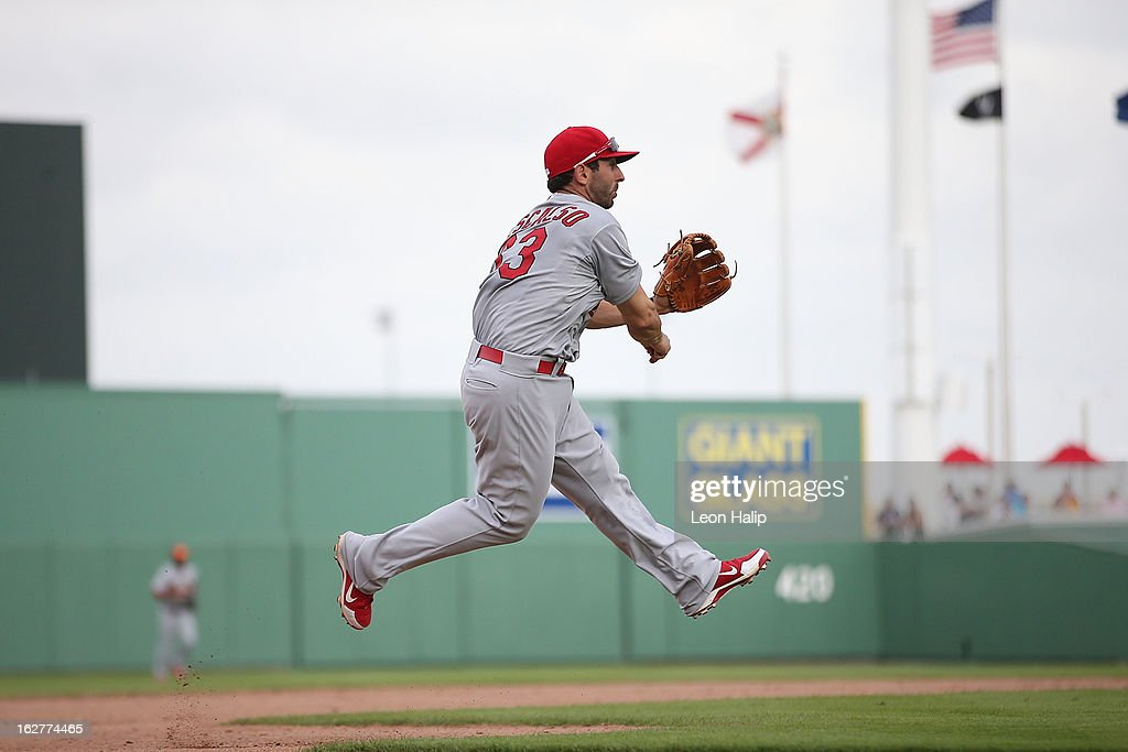 Daniel Descalso #33 of the St. Louis Cardinals fields the ground ball from Ryan Sweeney #25 of the Boston Red Sox in the fourth inning during the game at JetBlue Park on February 26, 2013 in Fort Myers, Florida.