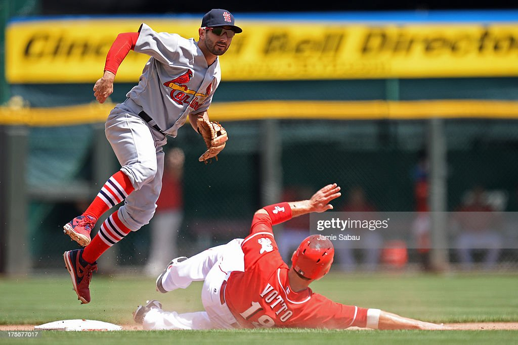<a gi-track='captionPersonalityLinkClicked' href=/galleries/search?phrase=Daniel+Descalso&family=editorial&specificpeople=6800752 ng-click='$event.stopPropagation()'>Daniel Descalso</a> #33 of the St. Louis Cardinals leaps over a sliding <a gi-track='captionPersonalityLinkClicked' href=/galleries/search?phrase=Joey+Votto&family=editorial&specificpeople=759319 ng-click='$event.stopPropagation()'>Joey Votto</a> #19 of the Cincinnati Reds at second base to complete a double play in the seventh inning at Great American Ball Park on August 4, 2013 in Cincinnati, Ohio. St. Louis defeated Cincinnati 15-2.