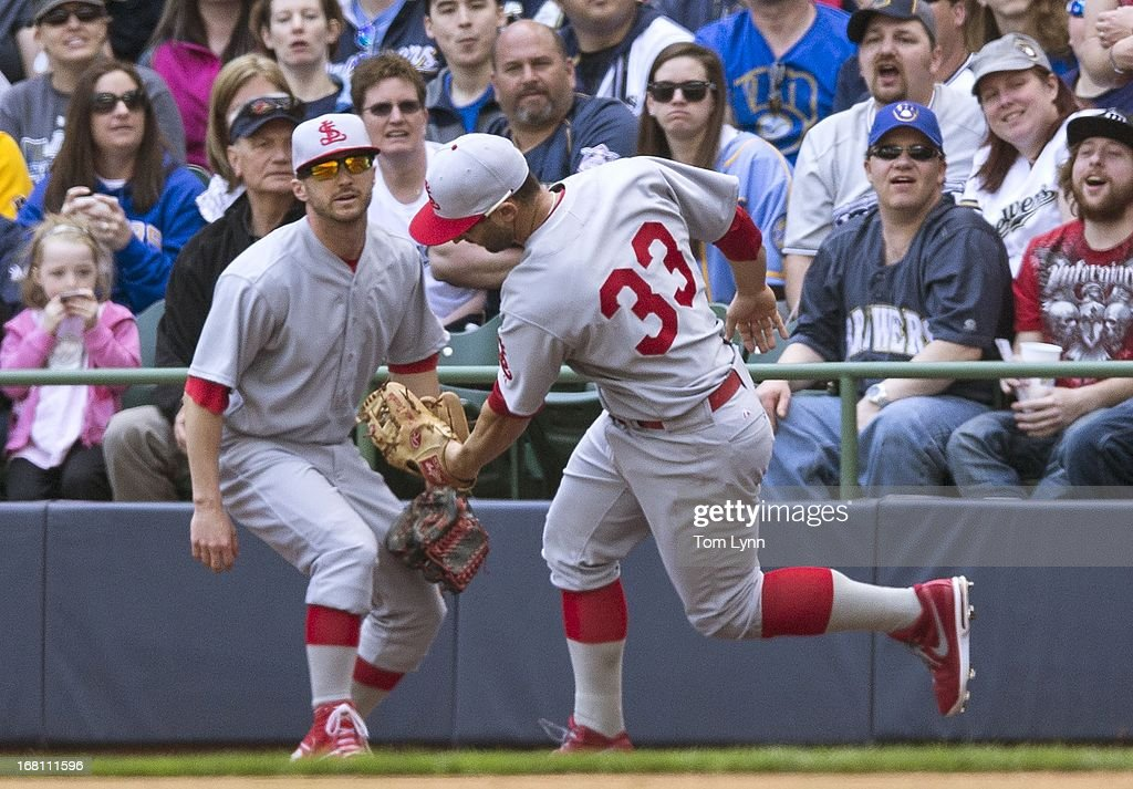 <a gi-track='captionPersonalityLinkClicked' href=/galleries/search?phrase=Daniel+Descalso&family=editorial&specificpeople=6800752 ng-click='$event.stopPropagation()'>Daniel Descalso</a> #33 of the St Louis Cardinals makes a catch during the fourth inning at Miller Park on May 5, 2013 in Milwaukee, Wisconsin.