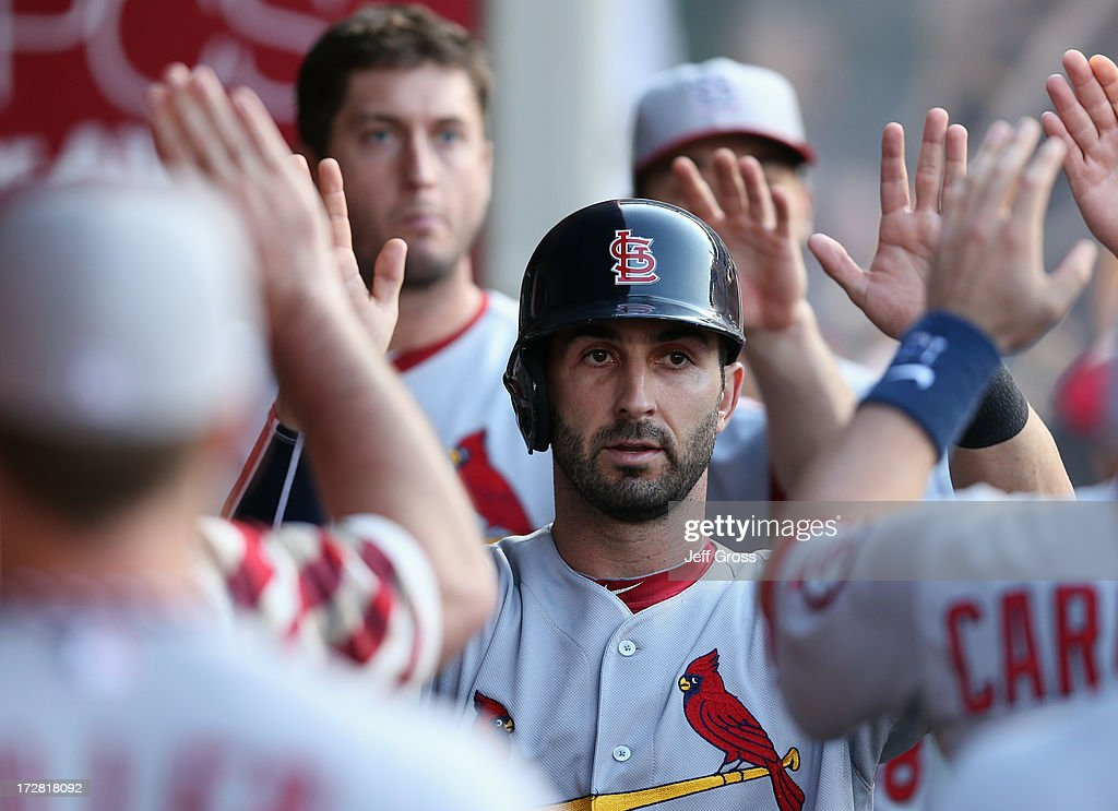<a gi-track='captionPersonalityLinkClicked' href=/galleries/search?phrase=Daniel+Descalso&family=editorial&specificpeople=6800752 ng-click='$event.stopPropagation()'>Daniel Descalso</a> #33 of the St. Louis Cardinals receives high fives in the dugout after scoring on a sacrifice fly against the Los Angeles Angels of Anaheim in the fifth inning at Angel Stadium of Anaheim on July 4, 2013 in Anaheim, California.