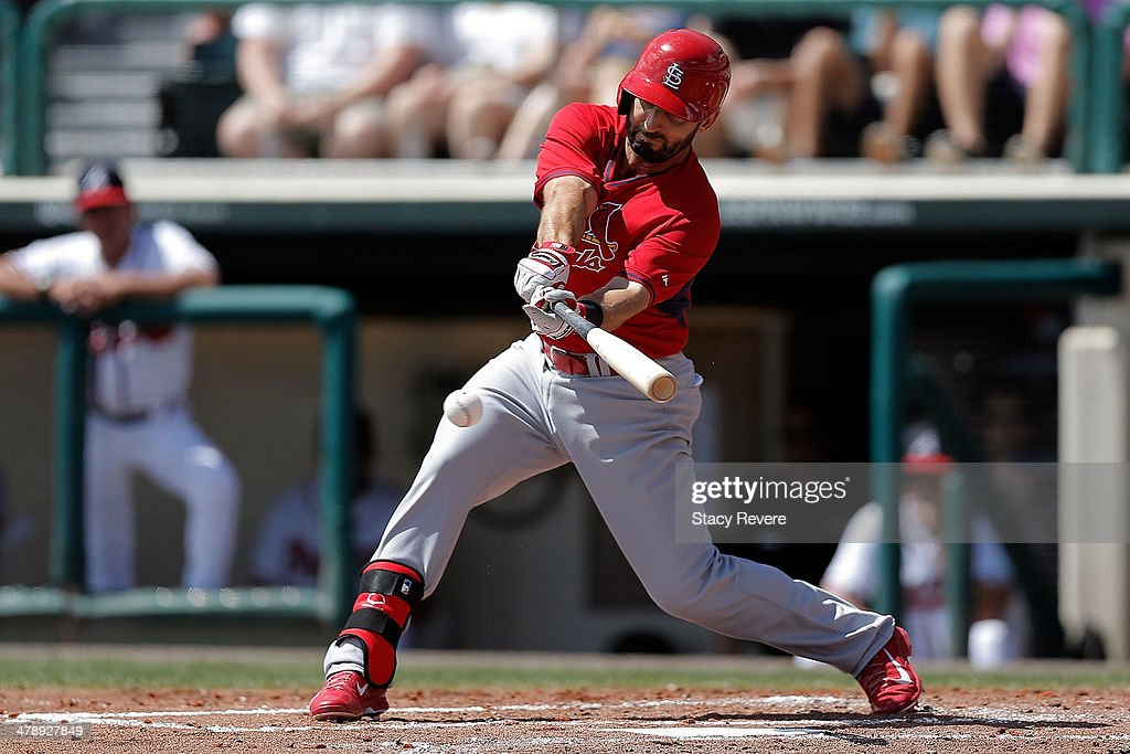 <a gi-track='captionPersonalityLinkClicked' href=/galleries/search?phrase=Daniel+Descalso&family=editorial&specificpeople=6800752 ng-click='$event.stopPropagation()'>Daniel Descalso</a> #33 of the St. Louis Cardinals swings at a pitch in the third inning of a game against the Atlanta Braves at Champion Stadium on March 15, 2014 in Lake Buena Vista, Florida. St. Louis won the game 6-2.