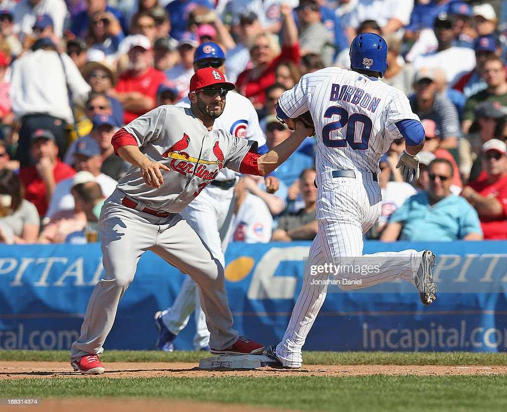 <a gi-track='captionPersonalityLinkClicked' href=/galleries/search?phrase=Daniel+Descalso&family=editorial&specificpeople=6800752 ng-click='$event.stopPropagation()'>Daniel Descalso</a> #33 of the St. Louis Cardinals tags out <a gi-track='captionPersonalityLinkClicked' href=/galleries/search?phrase=Julio+Borbon&family=editorial&specificpeople=4583545 ng-click='$event.stopPropagation()'>Julio Borbon</a> #20 of the Chicago Cubs at first base in the 7th inning at Wrigley Field on May 8, 2013 in Chicago, Illinois.