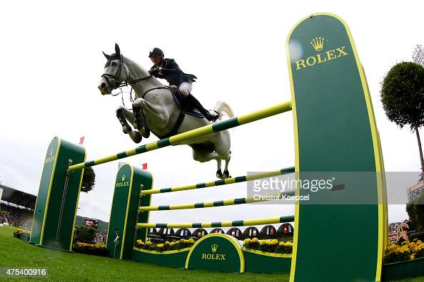 Daniel Deusser of Germany rides on Cornet d'Amour wand won the secodn place during the Rolex Grand Prix jumping competition of the 2015 CHIO Aachen...