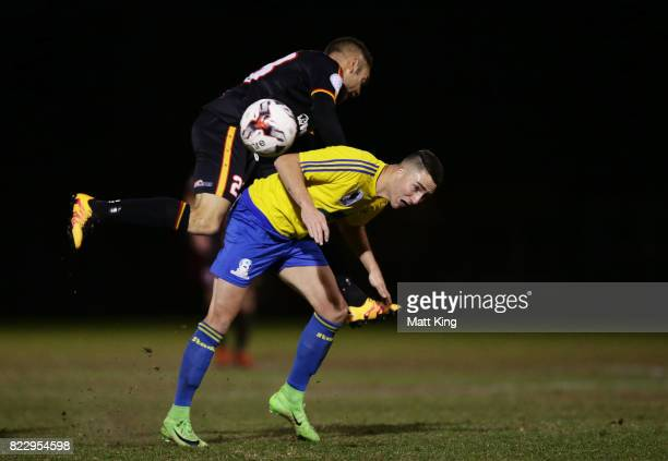 Daniel Di Ruocco of the Bankstown Berries is challenged by Christian Esposito of the MetroStars during the FFA Cup round of 32 match between...