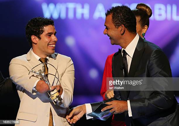 Daniel Dias receives his award for 'Laureus World Sportsperson of the Year with a Disablity' from Laureus Ambassador Ruud Gullit during the awards...