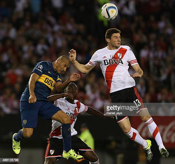 Daniel Diaz of Boca Juniors and Lucas Alario of River Plate go for a header during a match between River Plate and Boca Juniors as part of 24th round...