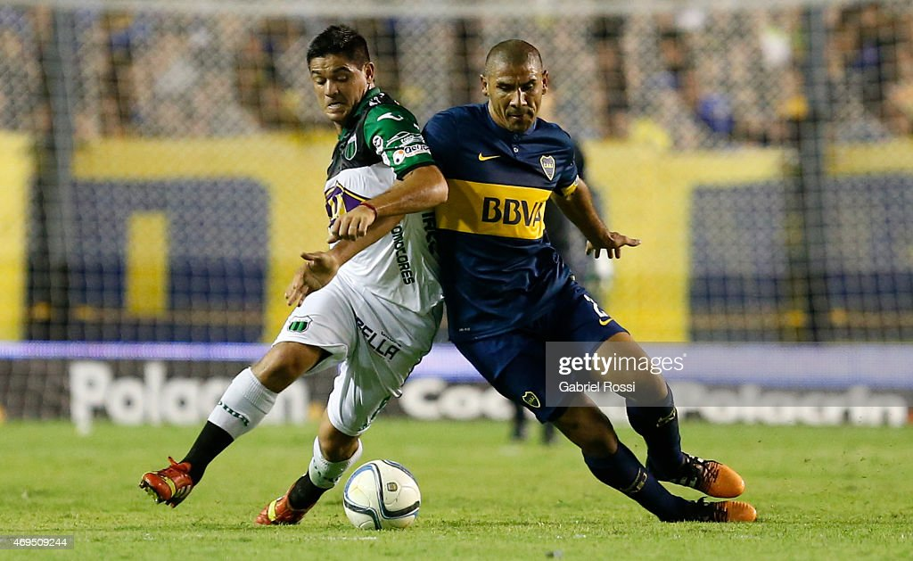 Daniel Diaz of Boca Juniors fights for the ball with Alejandro Gagliardi of Nueva Chicago during a match between Boca Juniors and Nueva Chicago as part of ninth round of Torneo Primera Division 2015 at Alberto J. Armando Stadium on April 12, 2015 in Buenos Aires, Argentina.